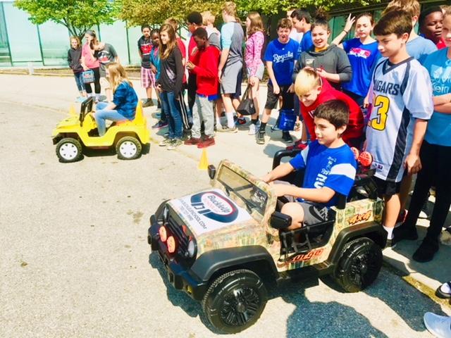 Children driving BuckleUp bigwheels
